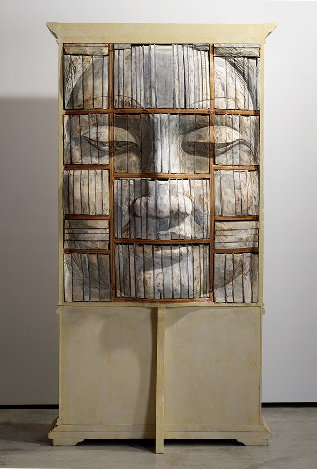 01-Book-Face-Mercy-Long-Bin-Chen-A-Second-Life-for-Recycled-Book-Sculpting-www-designstack-co