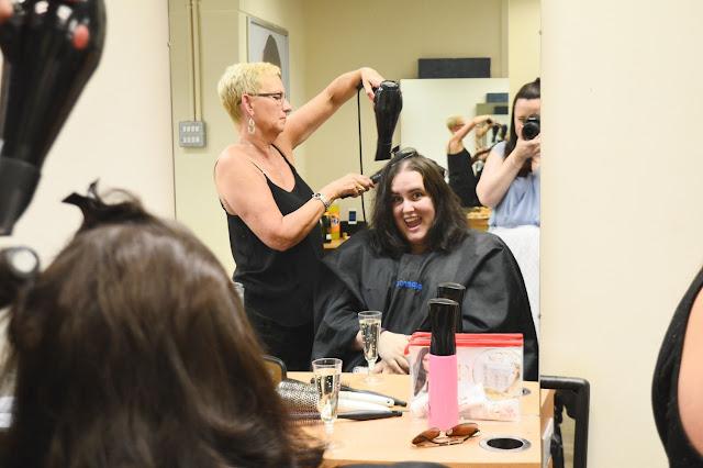 Blogger getting hair cut at Supercuts