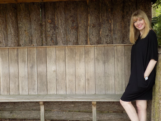Hope black cocoon dress and silver sandals