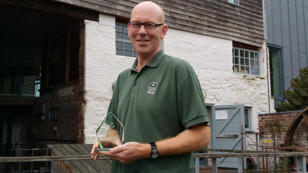 Devon Wildlife Trust's Paul Martin with the DEBI Award