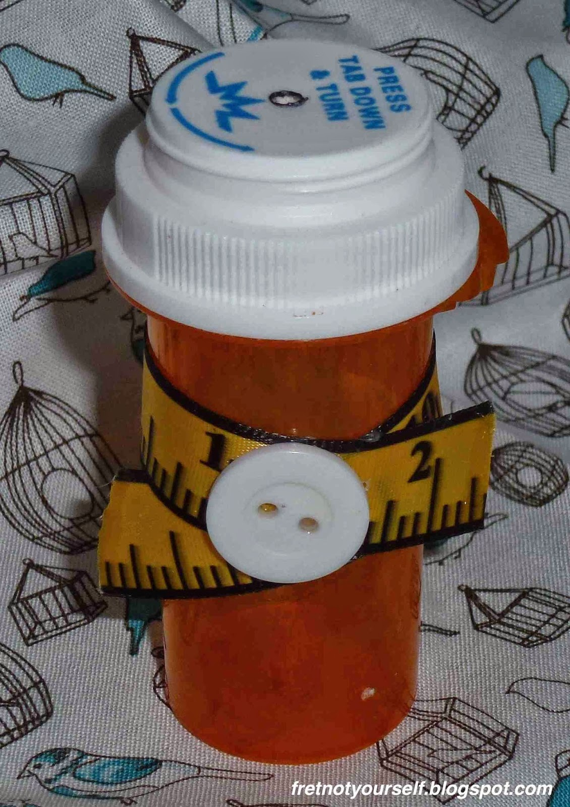A small pill box is used to safely store used pins and needles