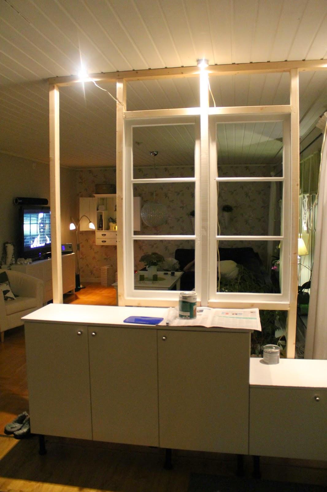 Nummer Trettiofyra: Ny innervägg av gamla fönster är på G