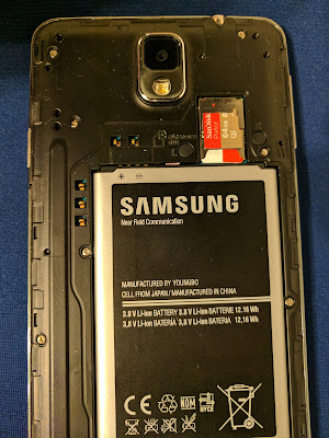 The contact points on the Note 3 are next to the top left corner of the battery compartment, two above it and three to the left.