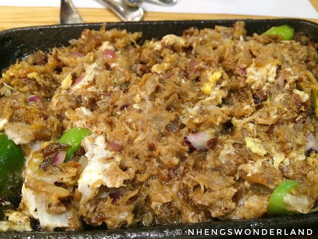Kuya J Restaurant - Sizzling Sisig w/ Egg