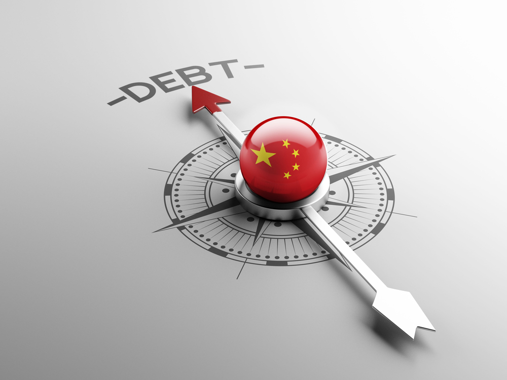 China's Flag on a Compass Pointing at Debt