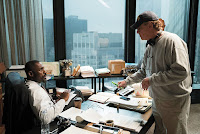 Aaron Sorkin and Idris Elba on the set of Molly's Game
