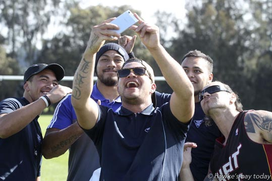 Back, centre: George Moala, All Black, posing with fans. Selfie by Haze Nukunuku, Hastings - six All Blacks visited Eskview Rugby Club at Petane Domain, Bay View. photograph