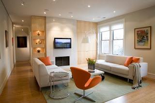 diseño sala blanco y naranja
