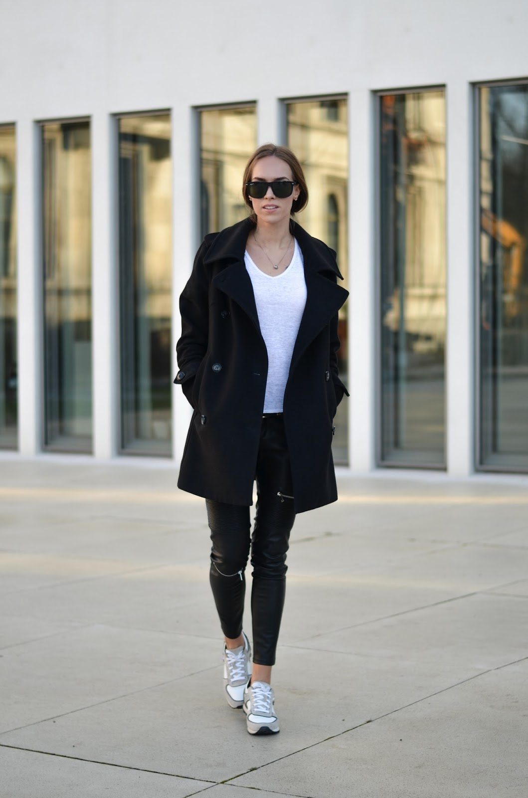 kristjaana mere black peacoat leather pants white sneakers causal style