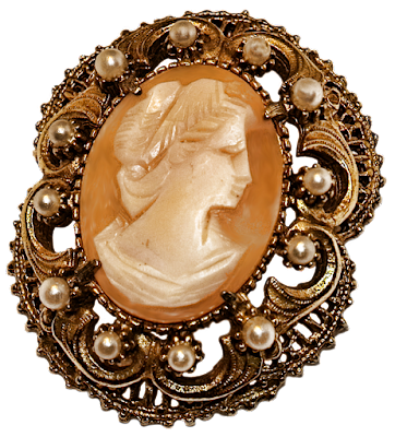 An older cameo pin with a finely detailed head, faux pearls and 10-karat gold plating.