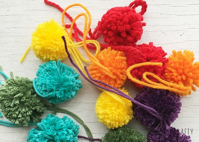 How to make Rainbow pom poms for Spring wall hanging