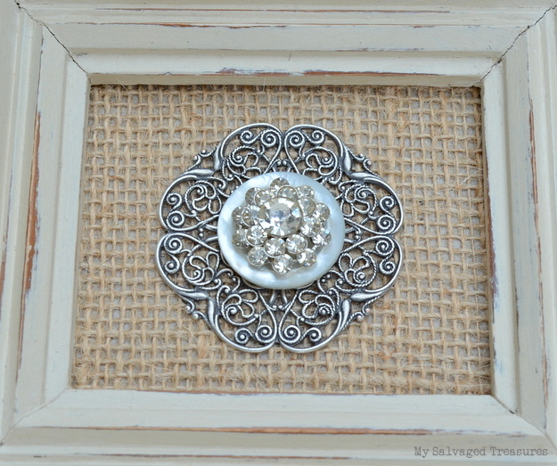 framed vintage rhinestone earring and button