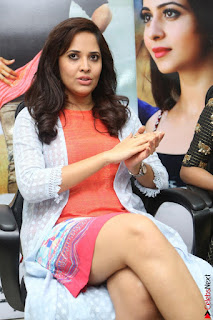 Actress Anasuya Bharadwaj in Orange Short Dress Glam Pics at Winner Movie Press Meet February 2017 (16).JPG