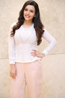 Kyra Dutt in Tight White Top Trousers at Paisa Vasool audio success meet ~  Exclusive Celebrities Galleries 029.JPG