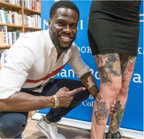 Kevin Hart poses with female fan who inked his face on her laps