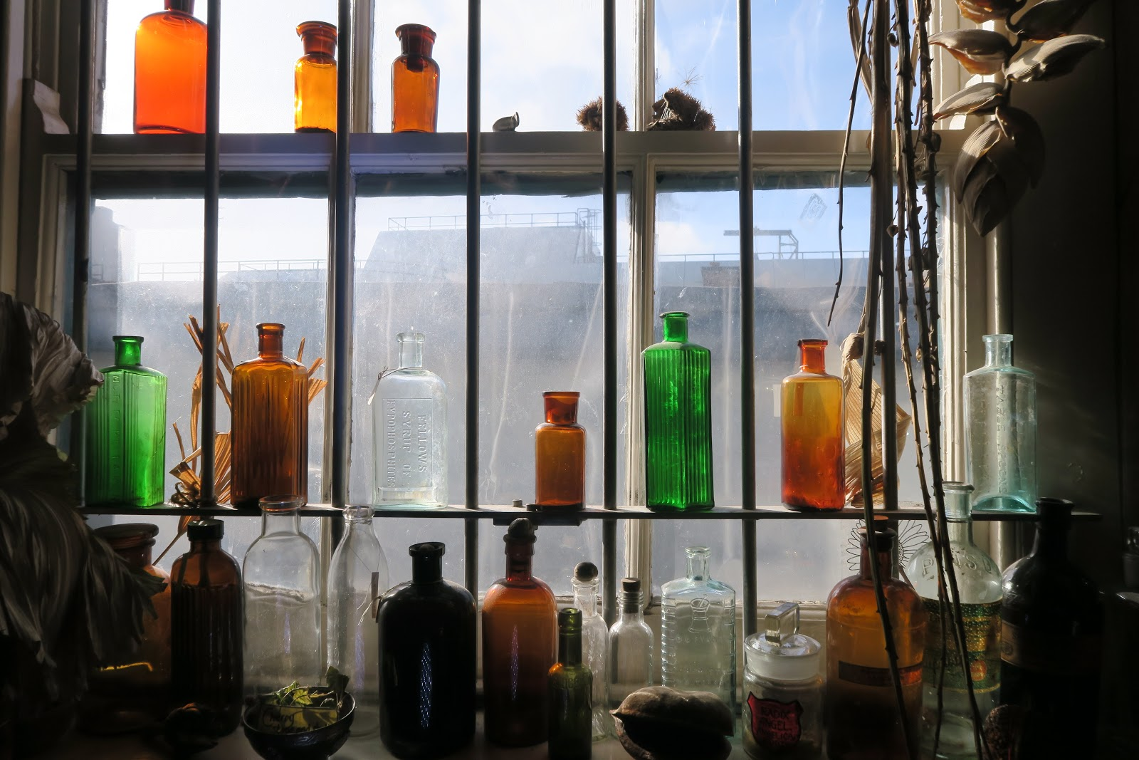 Glass bottles on windowsill