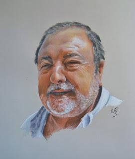 Retrato a pastel de un hombre con barba