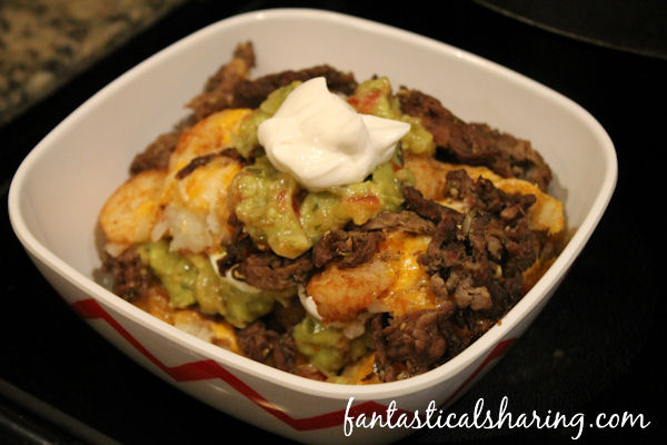 Totcho Supreme // Nachos just got better with this loaded tatortot version topped with delicious carne asada! #recipe #beef #nachos #tatortots