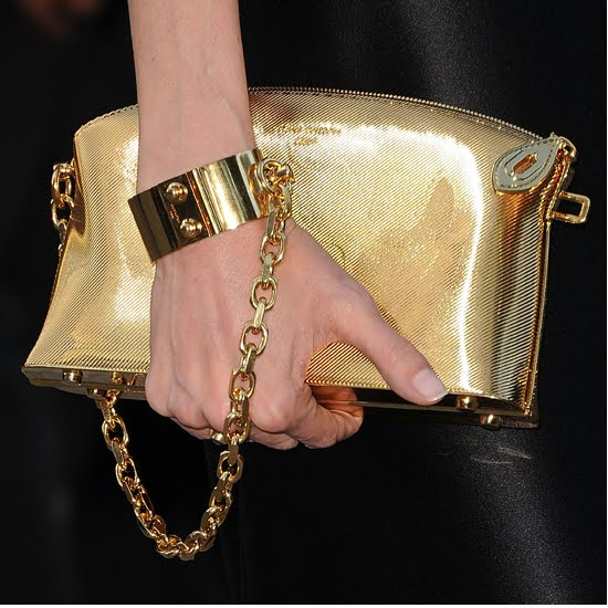 Because You Can Actually Handcuff It To Your Wrist Angelina Paired Hers With A Sleek Vivienne Westwood Gown Which Was Simplistic And Sophisticated