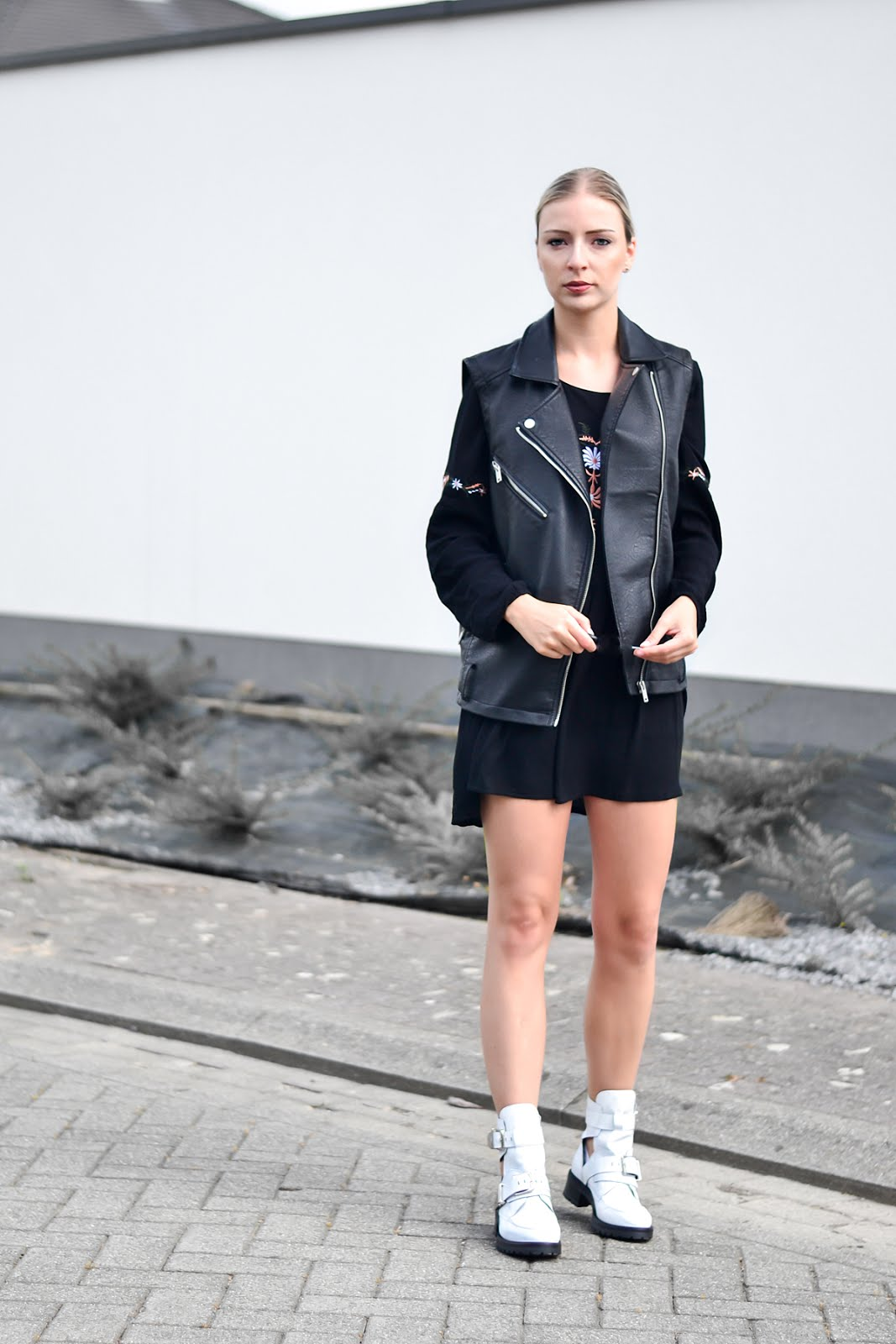 Festival look by Sacha shoes, Embroidered skater dress from moth clothing, white buckle boots, Jbc biker jacket
