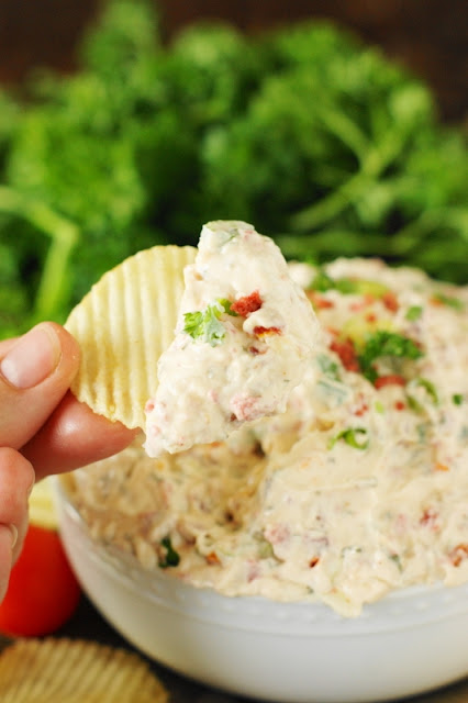 BLT Dip ~ This easy dip is loaded with great bacon flavor that's beautifully complimented by sun dried tomatoes & green onion.  Perfect for dipping those good ol' potato chips!   www.thekitchenismyplayground.com