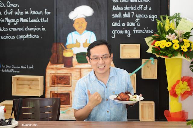 Thumbs up, I'm holding up the Nasi Lemak Kukus Ayam Goreng Berempah - RM15.90