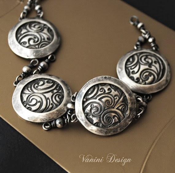 https://www.etsy.com/listing/197397764/massive-fine-silver-bracelet?ref=listing-0