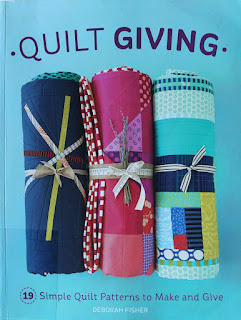 Quilt Giving by Deborah Fisher