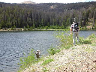 Fishermen at Boss Lake, catching trout.