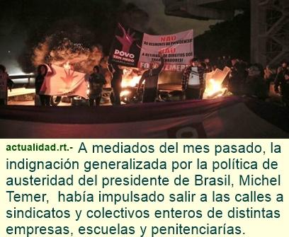 Incendios y bloqueos de calles en Río de Janeiro en violentas protestas contra reformas de Temer