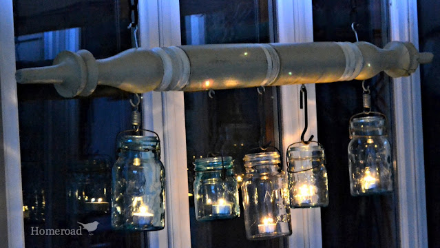 Hanging jars with lights on at night