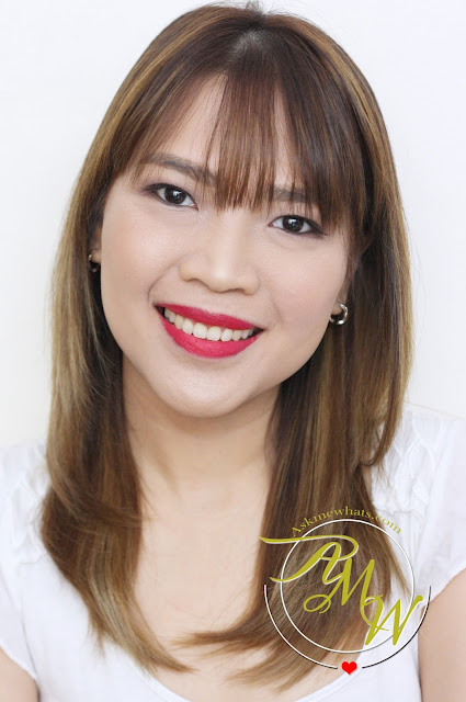 a photo of Nikki Tiu wearing CLINIQUE Pop Matte Rose Pop + Primer and Pop Liquid Color + Primer Flame Pop