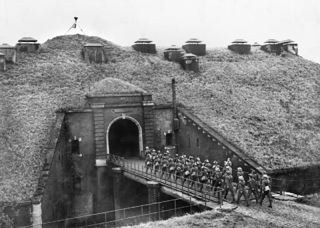 Troops of 51st Highland Division march over a drawbridge into Fort de Sainghain on the Maginot Line 1939. Situation Normal, and other stories of The Better Defense. marchmatron.com