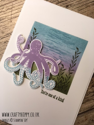 This picture shows a handmade card with an octopus and the words 'You're one of a kind'. It was made using the Sea of Textures stamp set and Balmy Blue ink by Stampin' Up!
