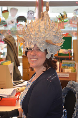 Rachael works at her desk wearing a Porcupine Fish Helmet