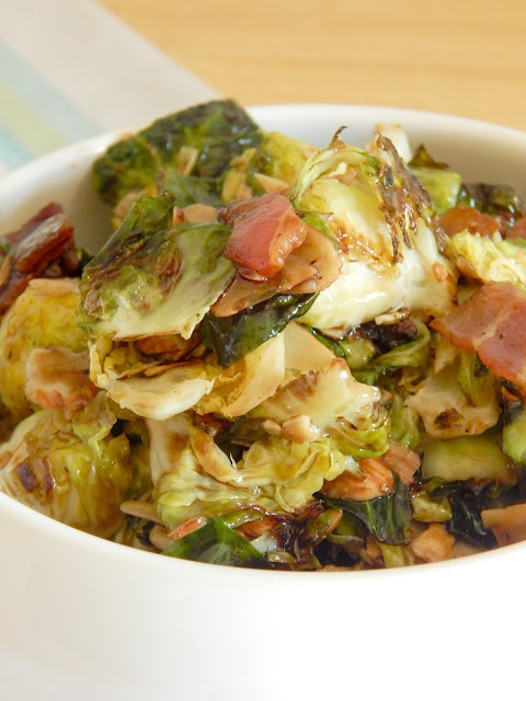 Crispy Brussels Sprouts with Bacon...this jazzed up veggie side dish is fun and new!  Roasting the brussels sprouts with bacon and tossing them in a sweet glaze makes them perfect for any dinner. (sweetandsavoryfood.com)