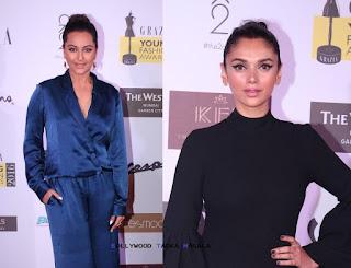 Sonakshi Sinha in a Verandah Jumpsuit with Aditi Rao Hydari in Madison Mini Dress at Grazia Young Fashion Awards 2016