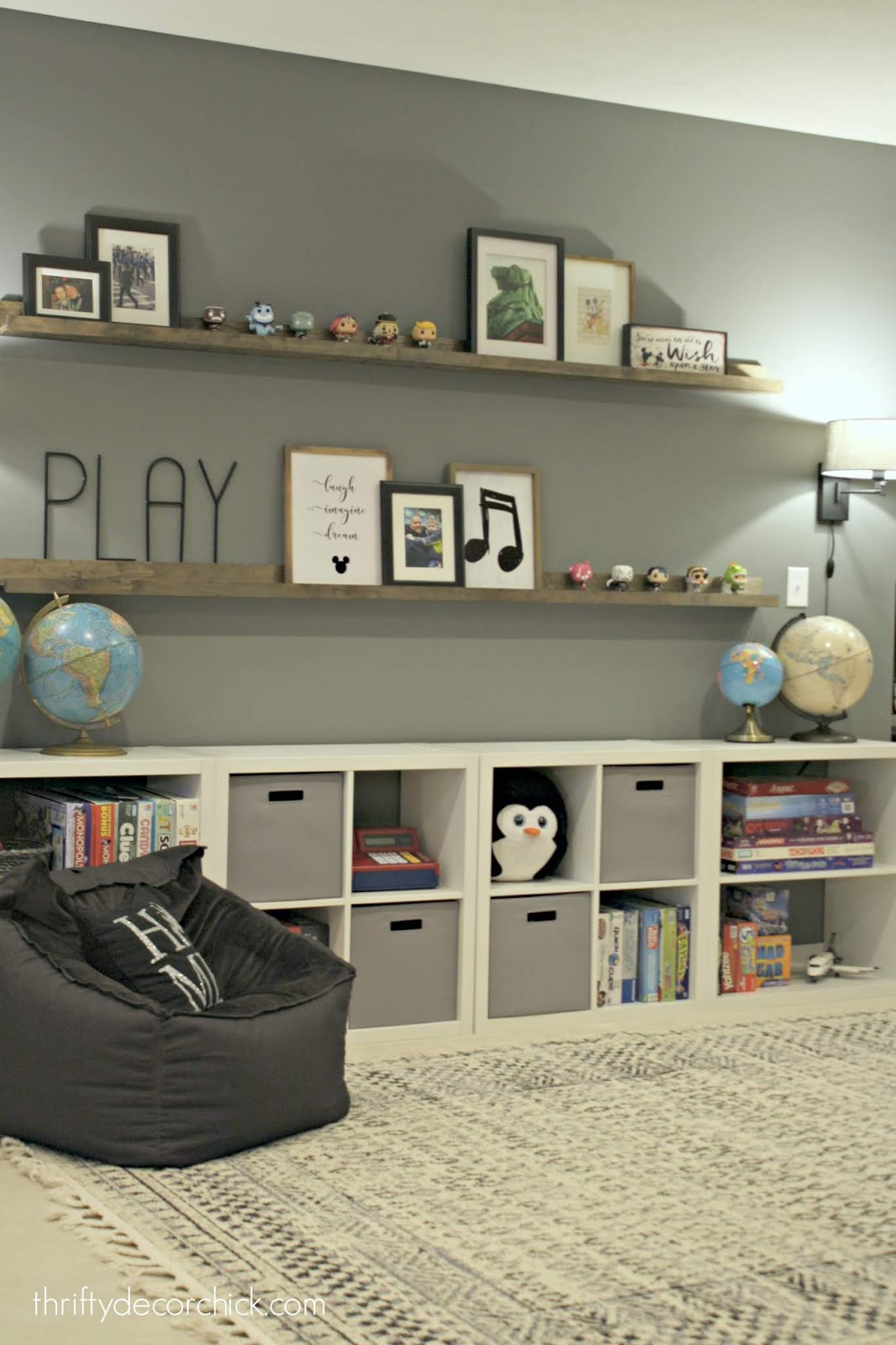 After -- filling a large wall with toy storage and pretty decor