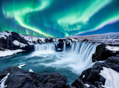 The Northern Lights over Iceland's Godafoss waterfall on the Diamond Circle