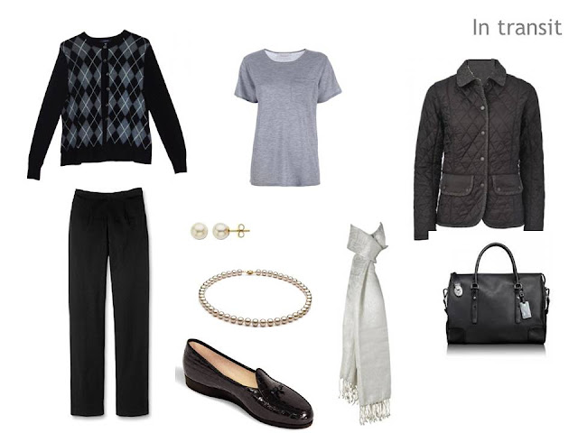 A simple travel outfit: black trousers, grey tee, argyle cardigan, and pearl jewelry