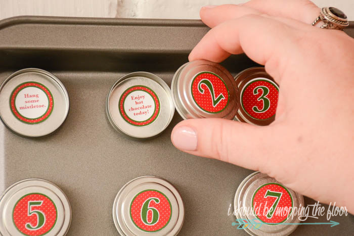 DIY Magnetic Advent Calendar   Download the free printable numbers and activities and follow the simple tutorial for this fun activity.
