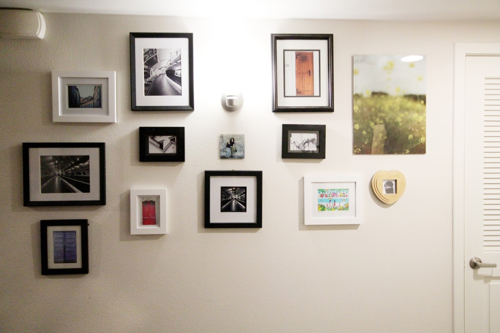 How to create a gallery wall in your home amused gallery walls are a favorite decor feature of mine having a personalized space set aside for a display of fond memories love destinations jeuxipadfo Images