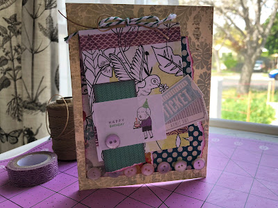 Card with altered paper clip embellishment