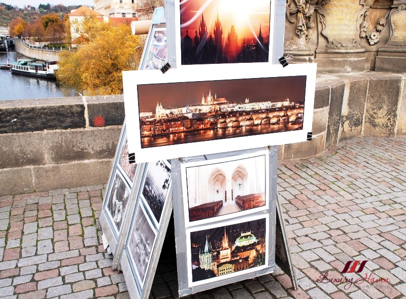 eu holidays prague sightseeing charles bridge paintings