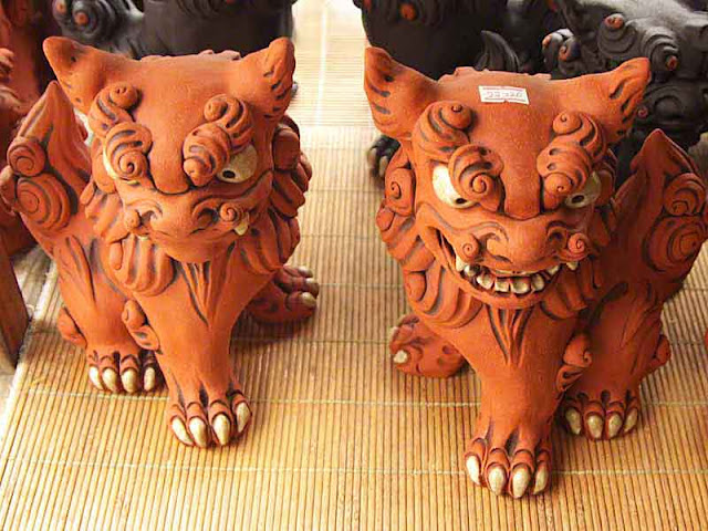 Pair of male and female Shisa statues