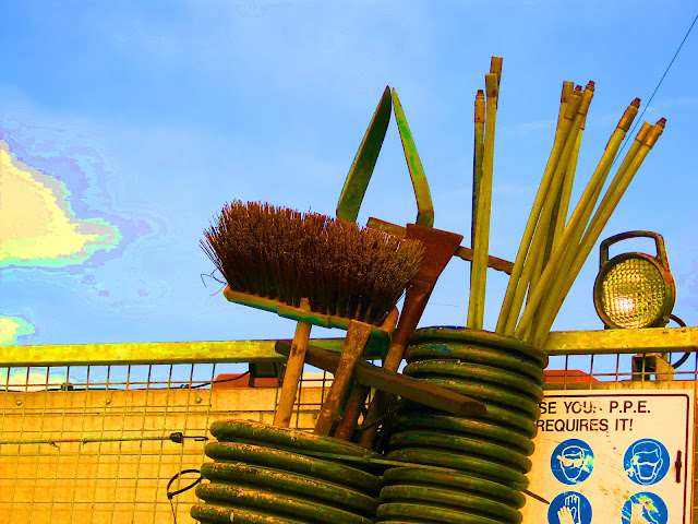 Broom and other worker's implements on a lorry - bright colours