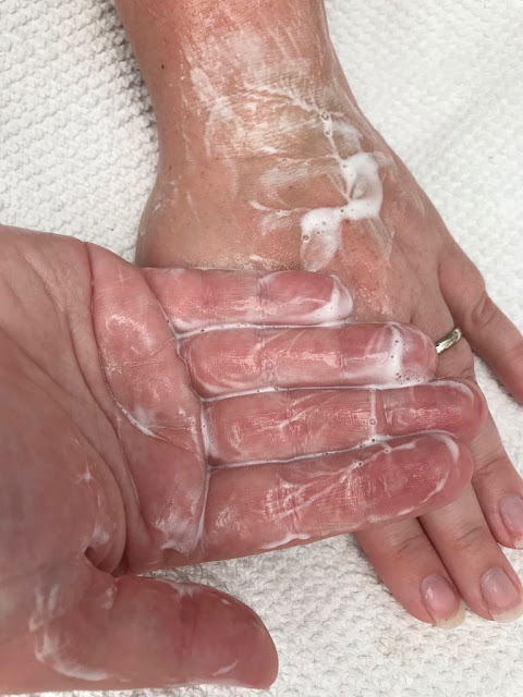 Soaped up shampoo on a pair of hands