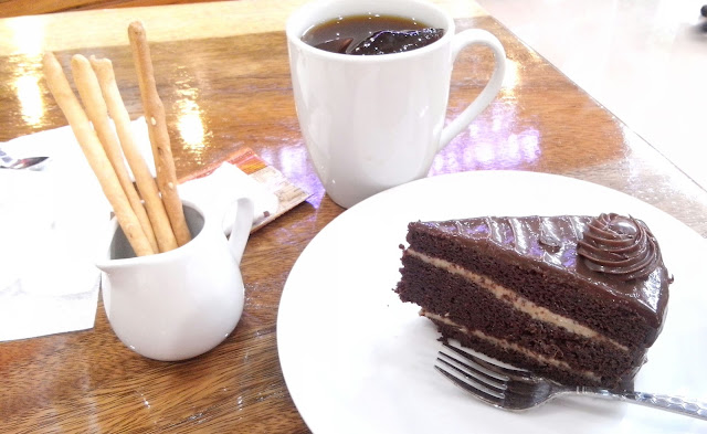 My moist chocolate cake partnered with Sweet Solutions blend coffee. I was served garlic sticks