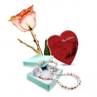 Classic combo - rose, pearls, and chocolate from Howard's Jewelry Center