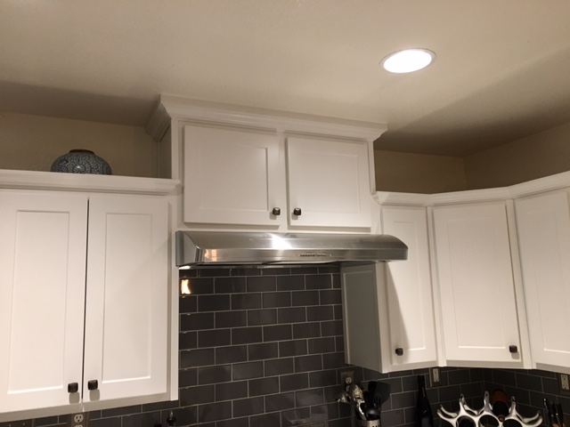 renovated kitchen, gray and white lifted cabinets
